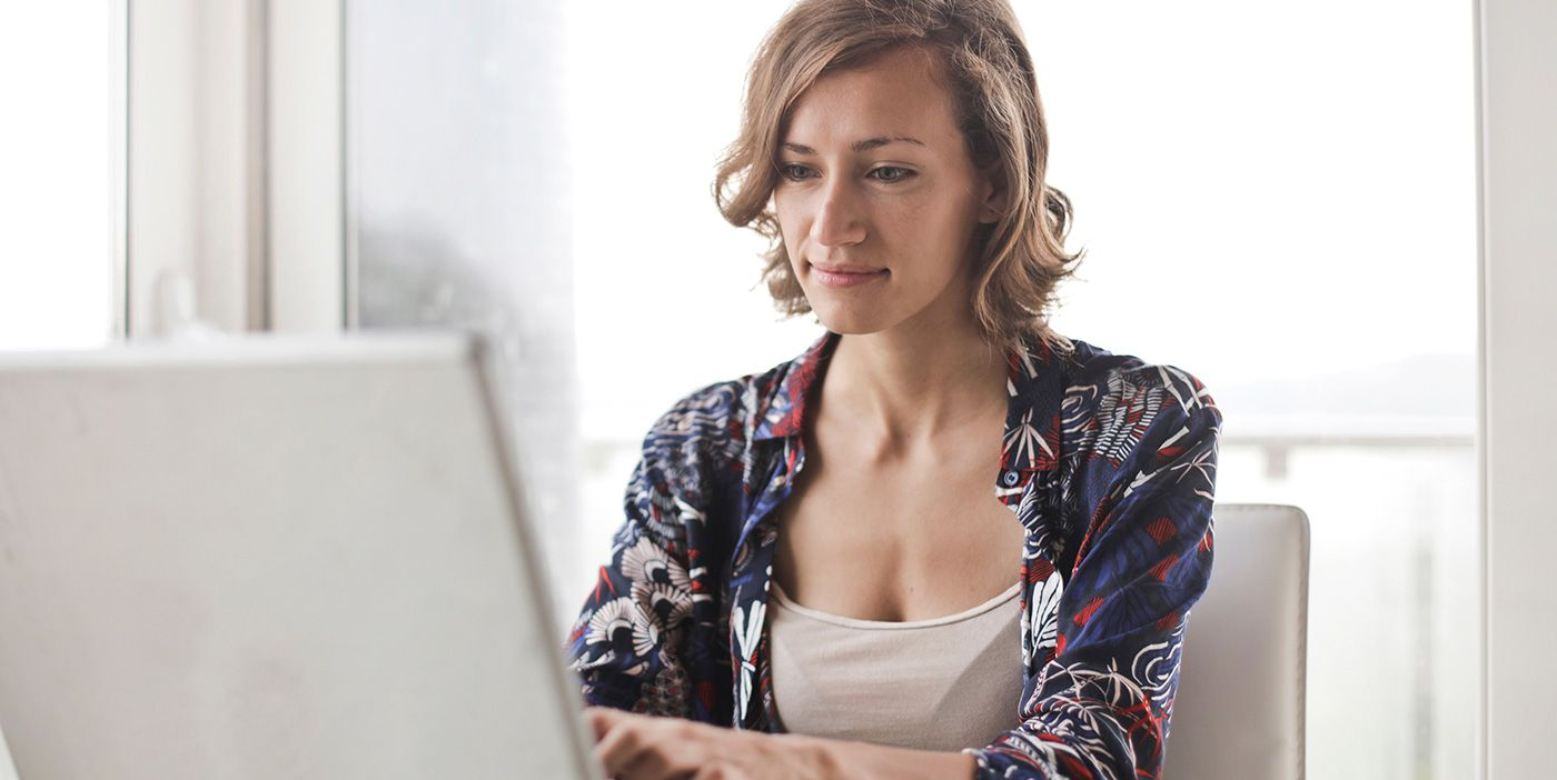 woman reselling on computer
